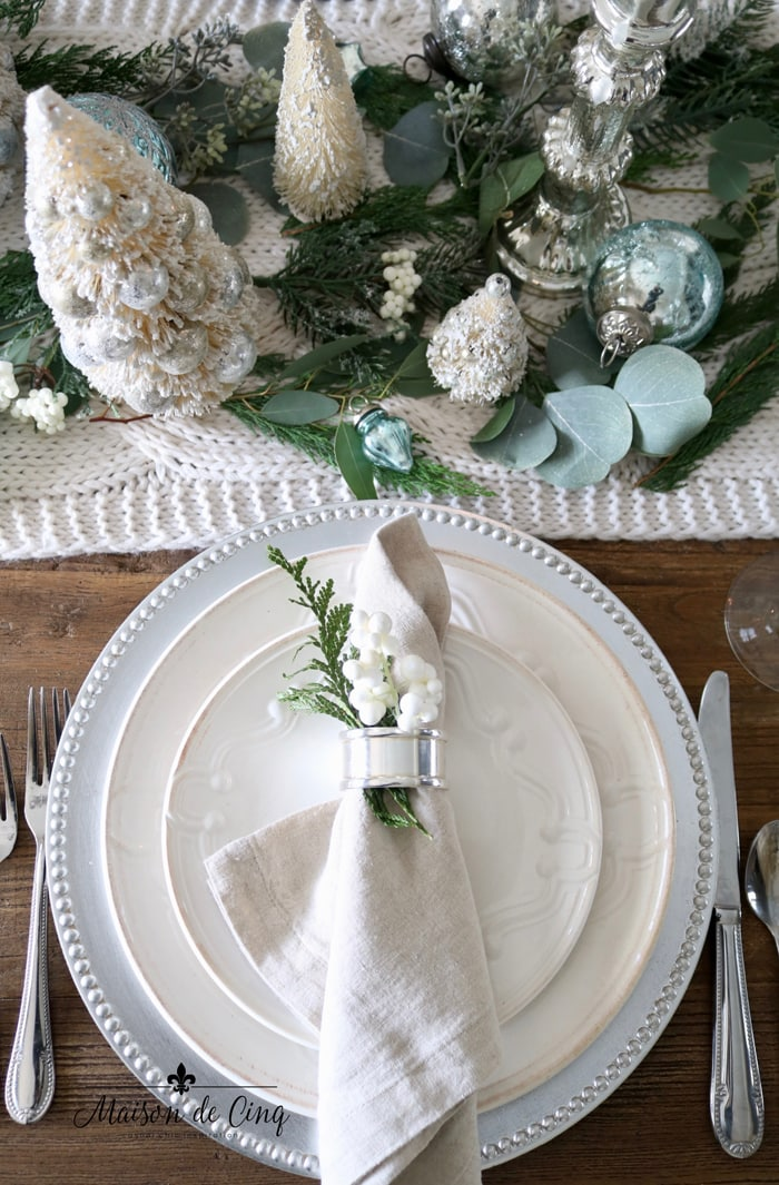 gorgeous Christmas table setting idea with white bottle brush trees and silver and blue ornaments