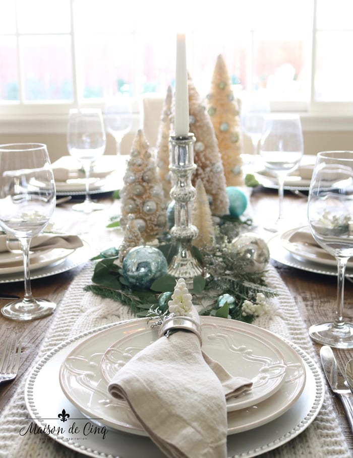 Christmas table setting with bottle brush trees and touches of soft French blue
