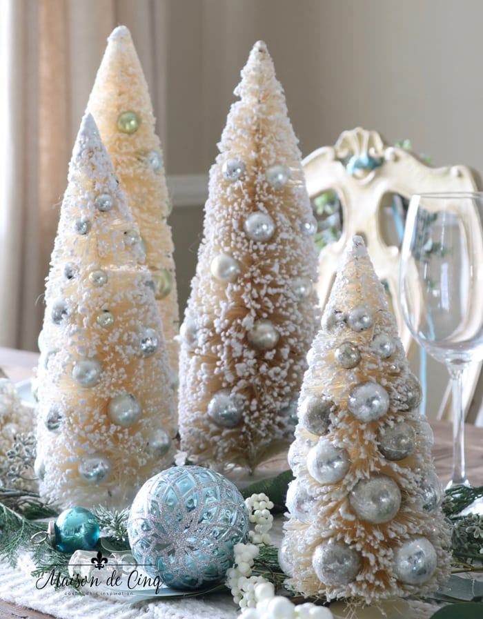 blue ornaments with white and silver bottle brush trees holiday table setting ideas