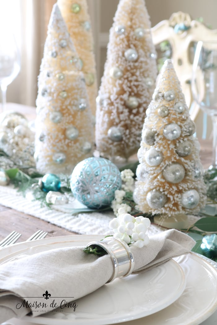 blue ornaments white bottle brush trees gorgeous holiday tablescape