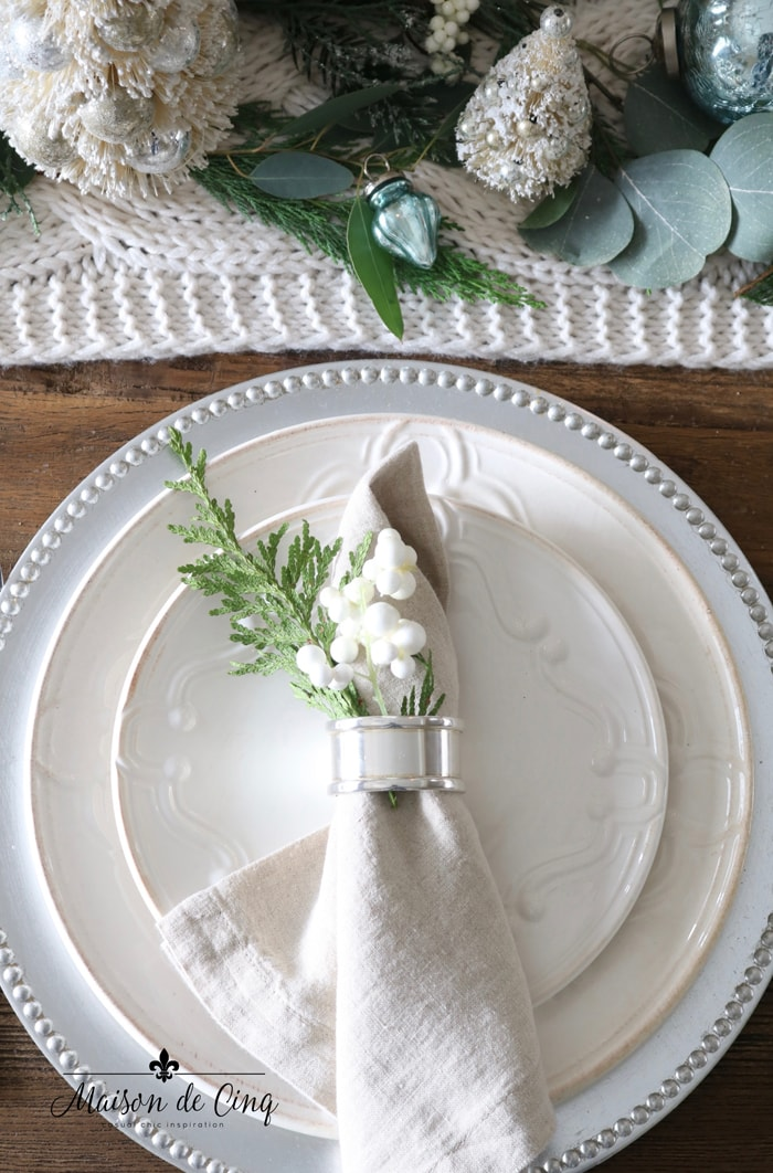 white plates silver chargers and napkin rings Christmas table pretty in white