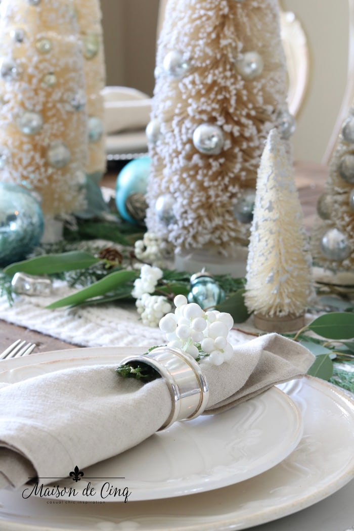 linen napkin silver napkin holder white plates and greens holiday table