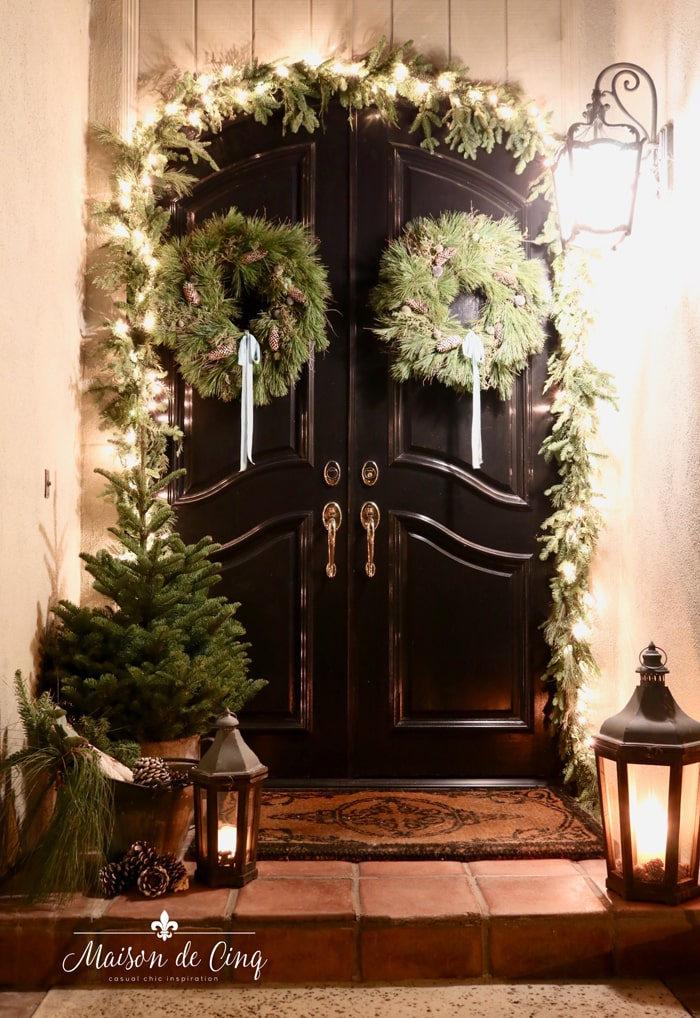 gorgeous christmas porch lights garland and wreaths black doors
