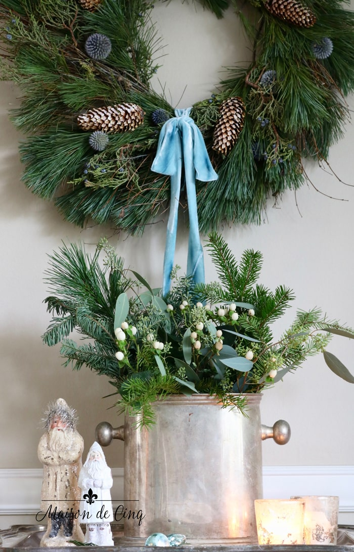 wreath with blue ribbon and greens in vintage silver champagne bucket Christmas decor