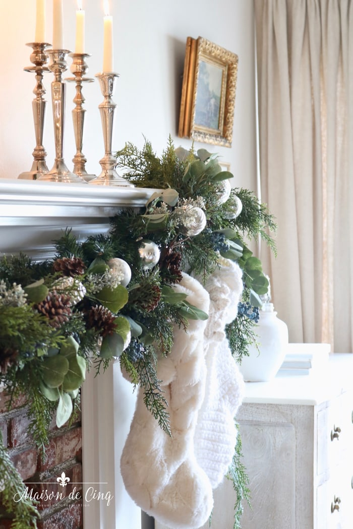 gorgeous christmas garland with ornaments and pinecones stockings