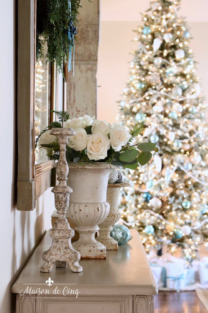 white roses in vintage urn French inspired Christmas tour tree with blue ornaments