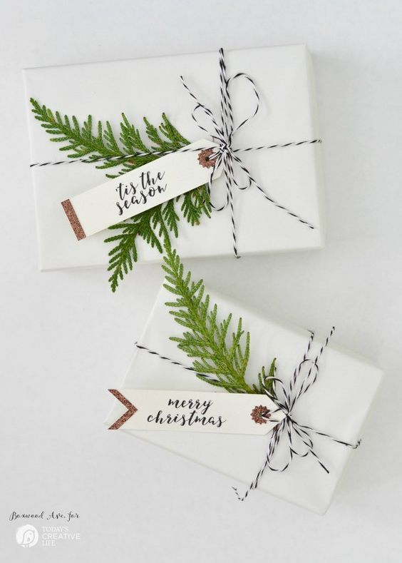 white holiday gift with string and greens