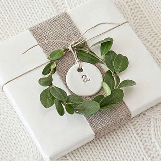 gift with white wrapping paper with clay tag