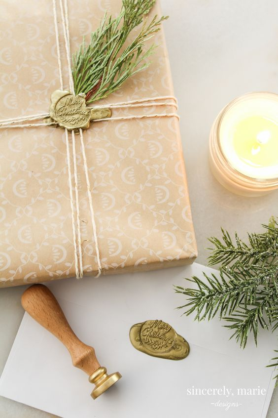 christmas gifts wrapped with wax seals and rosemary