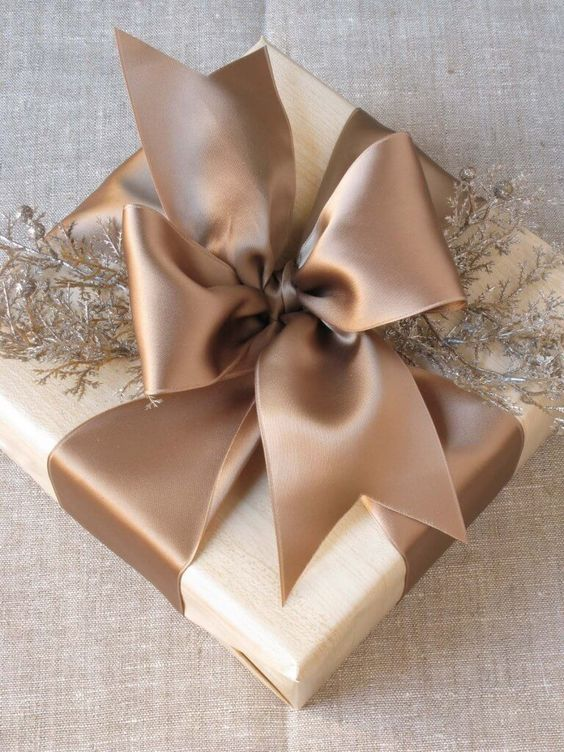 holiday gift wrapping tone on tone with gorgeous bow