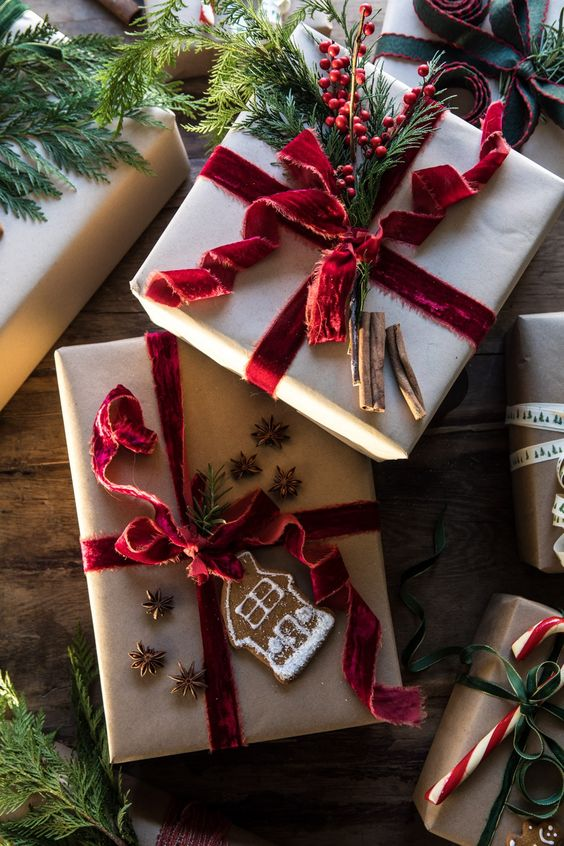 cute holiday gifts with red velvet ribbon and greens