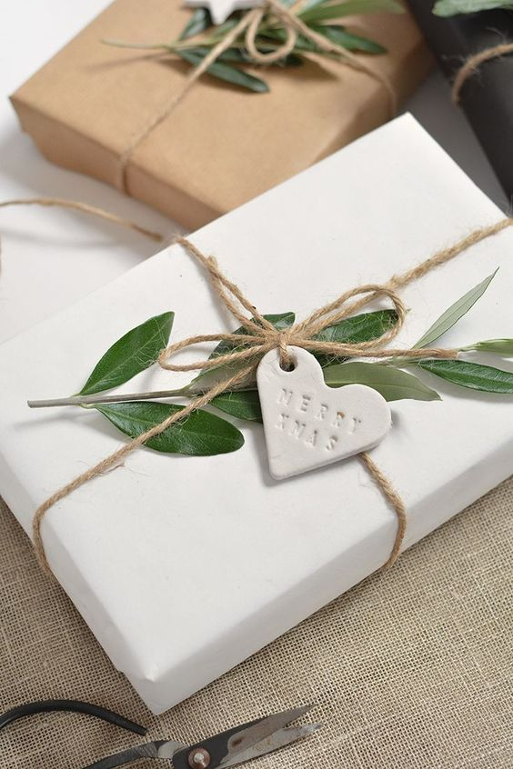 gifts in white paper with clay tags