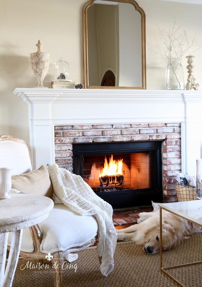 cozy nights by the fire fireplace mantel with mirror French country room