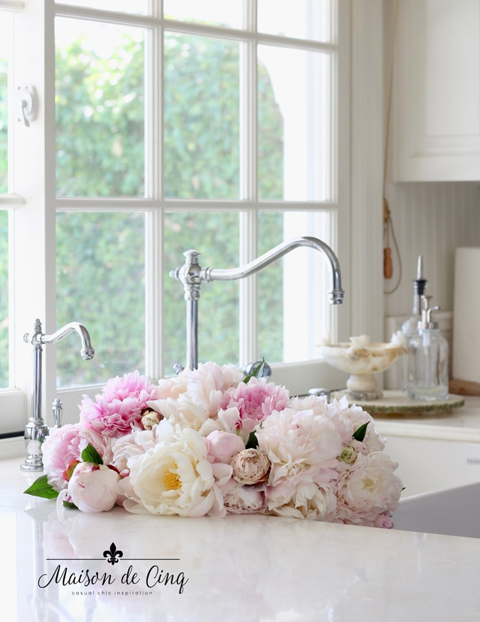 gorgeous peonies in kitchen sink white farmhouse kitchen organizing tips hacks for the kitchen