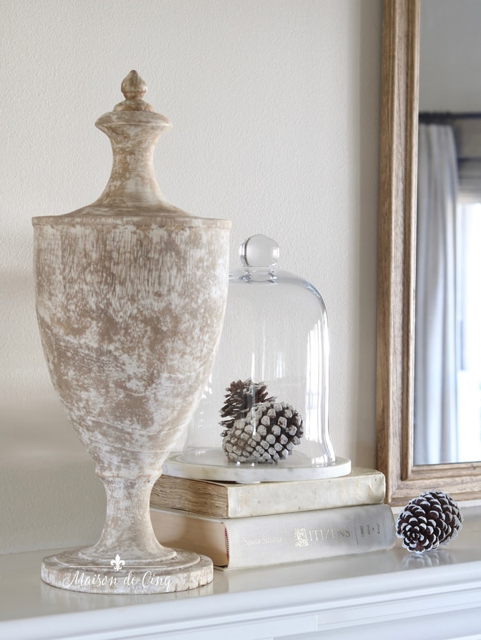 pinecones under glass dome and French finial urn