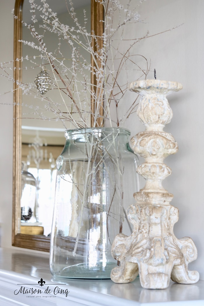 winter decor ideas branches in vase with silver ornaments on mantel