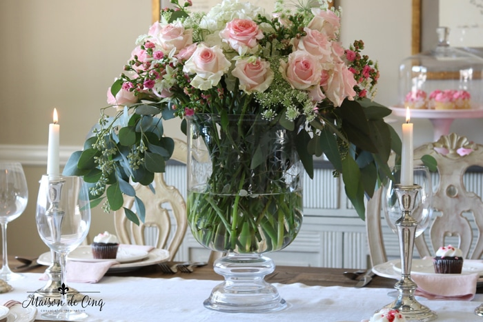 gorgeous Valentine's day table setting with pinks roses and candles