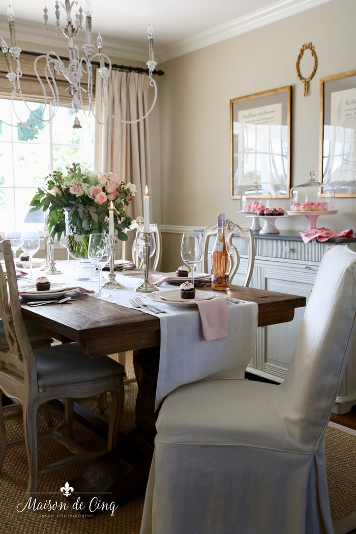 pretty French farmhouse dining room with pink and white table setting