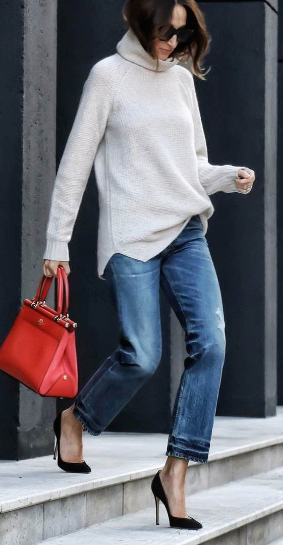 chunky turtleneck cropped jeans and red handbag chic street style