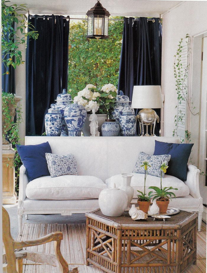 decorating with blue gorgeous outdoor space with white sofa and ginger jars