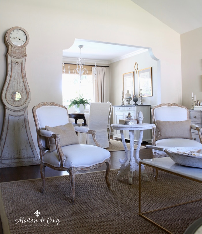 gorgeous French country living room with Mora clock neutral room decorating with texture