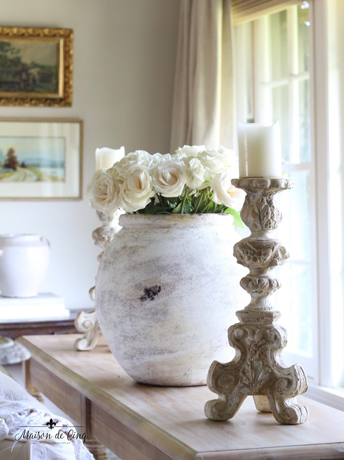 gorgeous french country living room with roses in urn decorating with texture