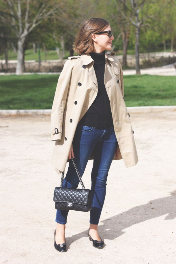 trenchcoat outfit with black sweater and jeans black flats Chanel bag
