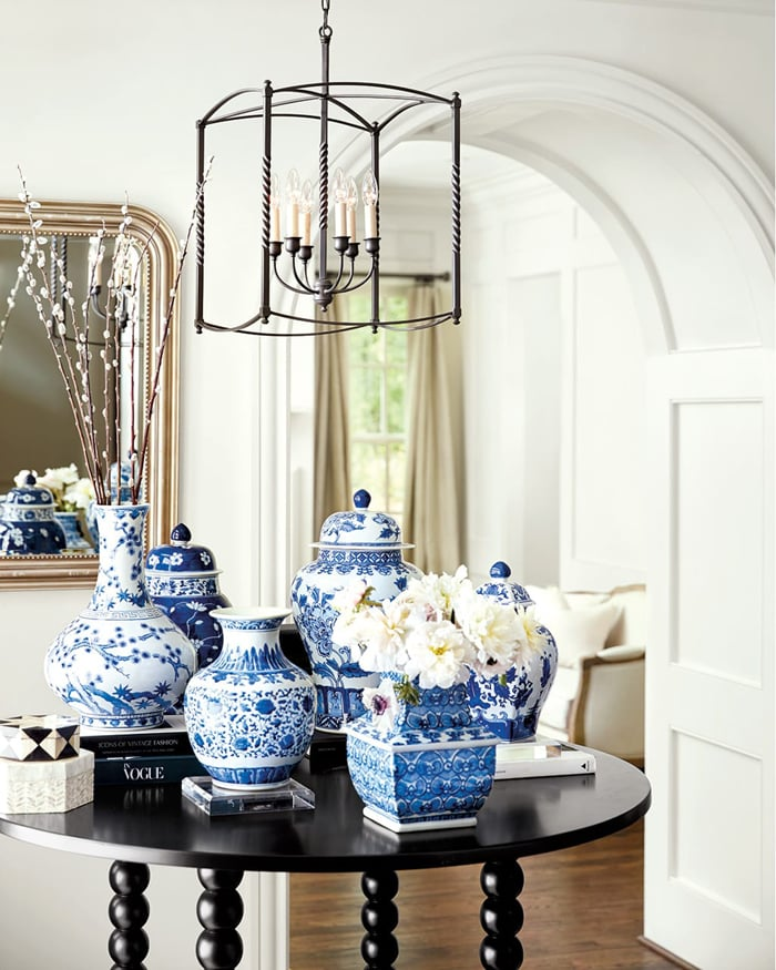 blue and white ginger jars on entry way table gorgeous vignette French country style