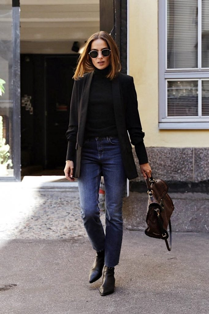 chic French winter fashion with jeans and boots black outfit street style