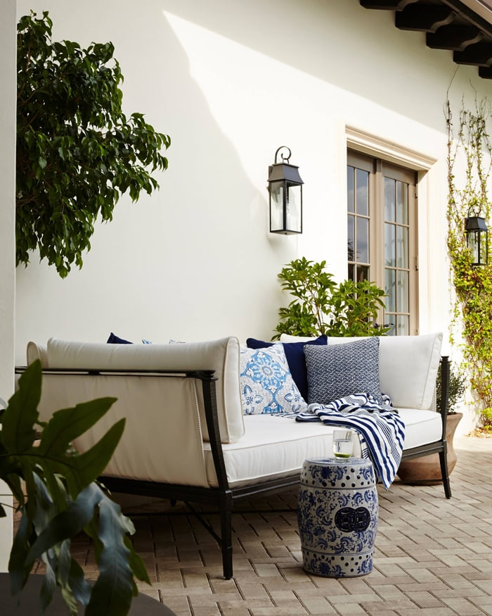 gorgeous outdoor space daybed with blue pillows