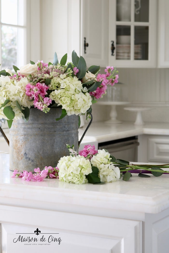 simple spring styling with flowers in vintage galvanized bucket white farmhouse kitchen