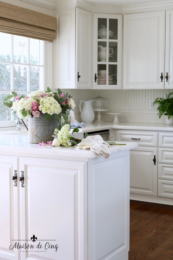 pretty white French farmhouse kitchen with spring flowers decorating ideas