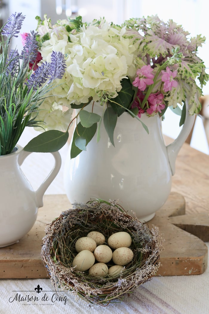simple spring styling with flowers in ironstone pitcher and nest with eggs