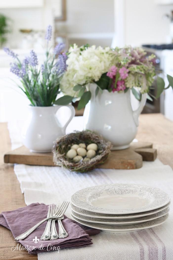 kitchen table spring vignette flowers nest with eggs pretty plates lavender napkins