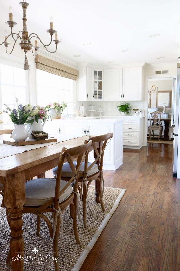 gorgeous white farmhouse kitchen spring decorating ideas flowers on table