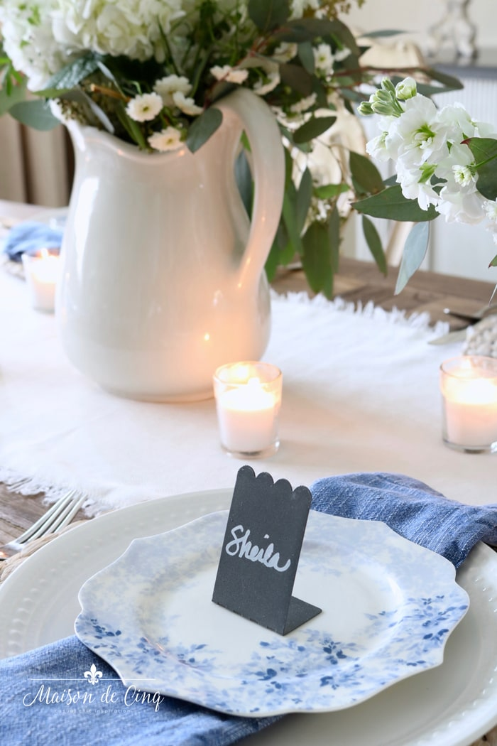 chalkboard place card on blue floral plate blue napkin pretty spring table setting
