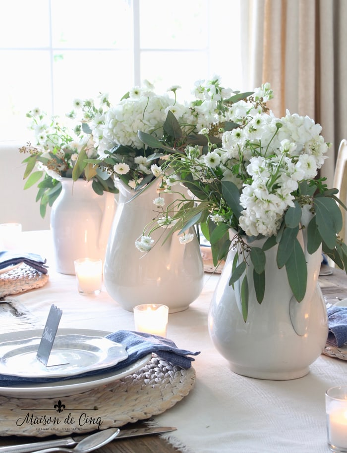 white ironstone pitchers with white flowers simple spring tablescape