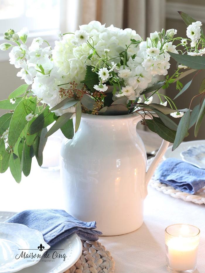 white hydrangeas and chamomile in white pitcher spring tablescape idea