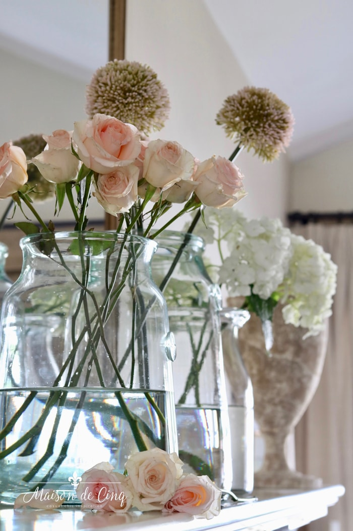 gorgeous spring mantel with pink rose allium and white hydrangeas spring vignette mantelscape