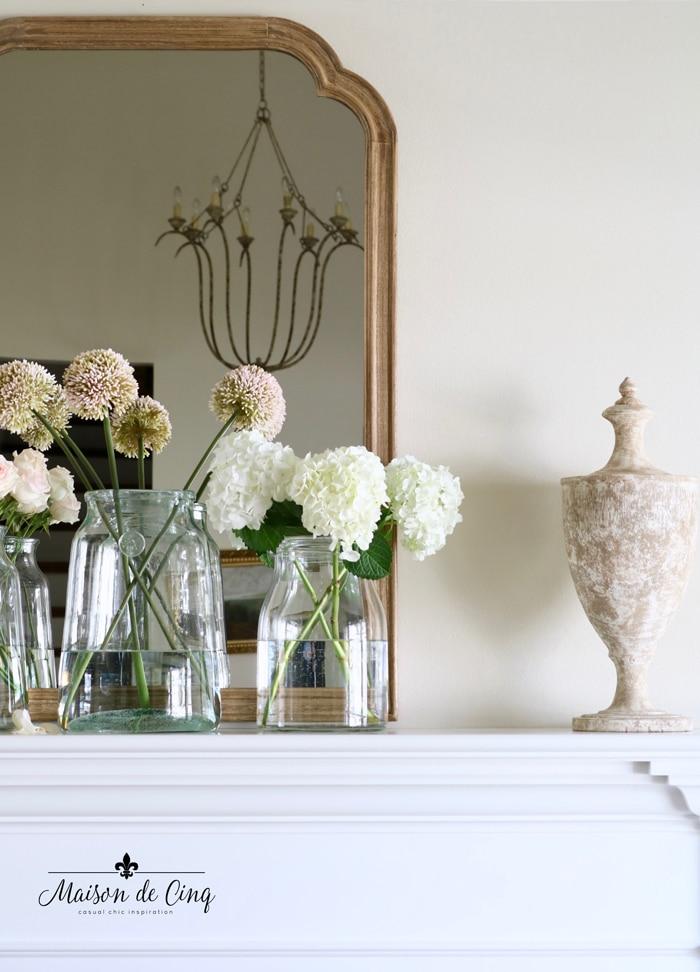 white hydrangeas pink roses and allium spring decorating idea mantelscape