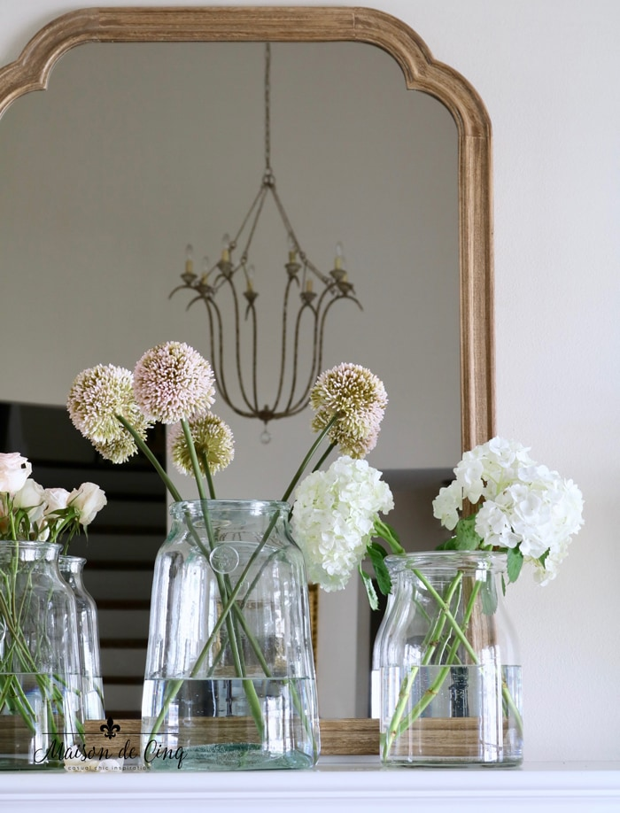 French country mirror with flowers in glass vases spring mantel decorating ideas