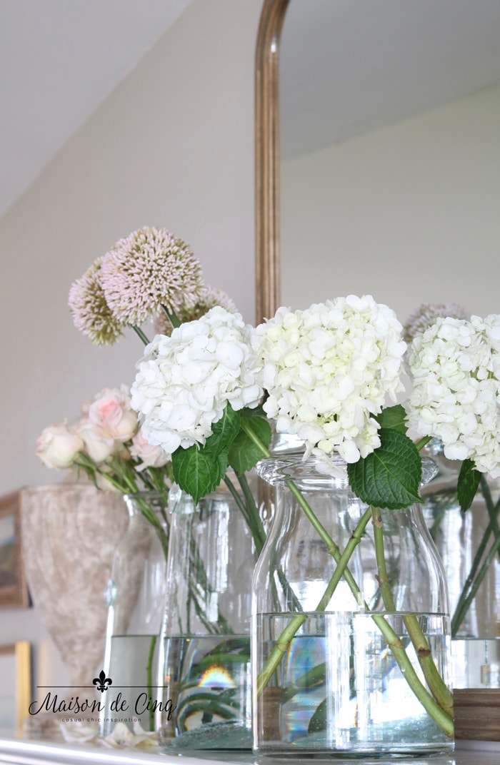 easy spring decorating ideas with pink and white flowers in glass vases mantel decor