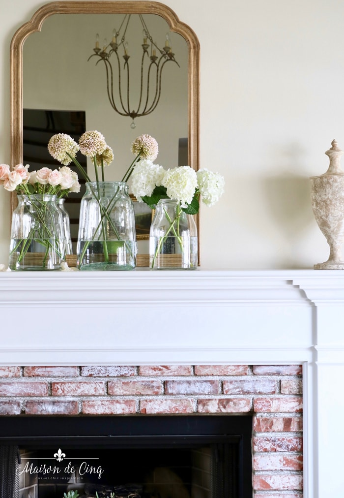 easy spring decorating flowers in glass vases mantel French country living room