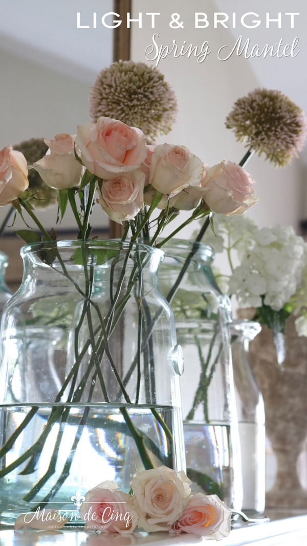 light and bright spring mantel decor with pink and white flowers