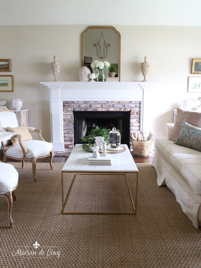French country living room fireplace with brick