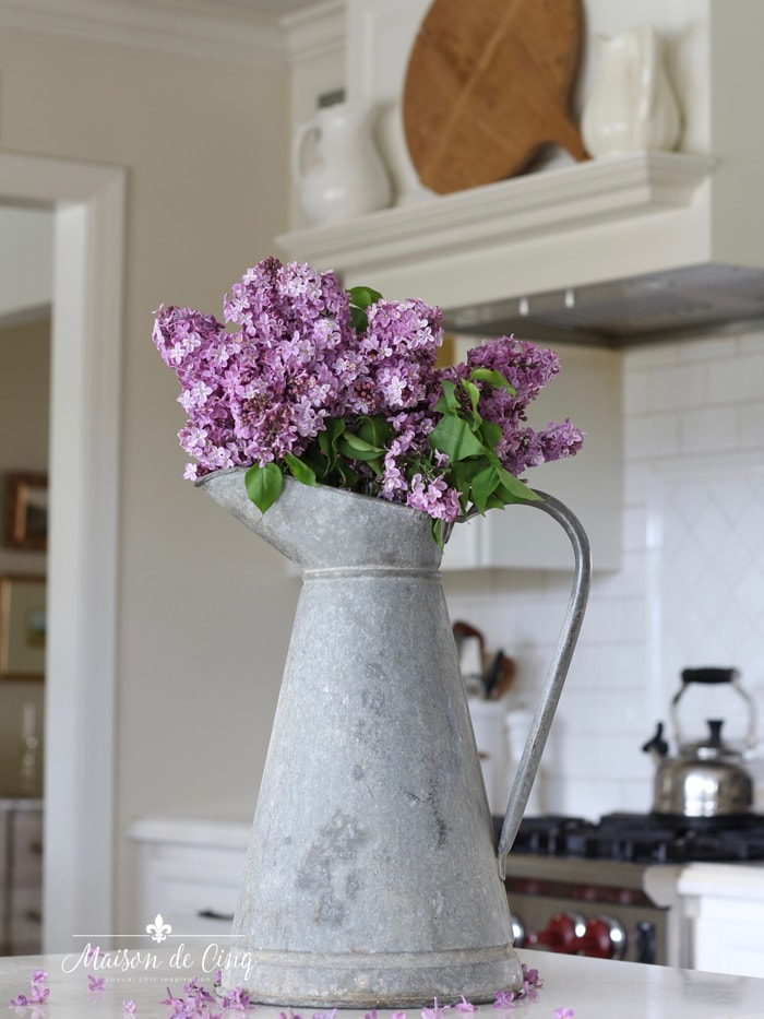 decorating with flowers on a budget gorgeous lilacs in galvanized pitcher French country kitchen