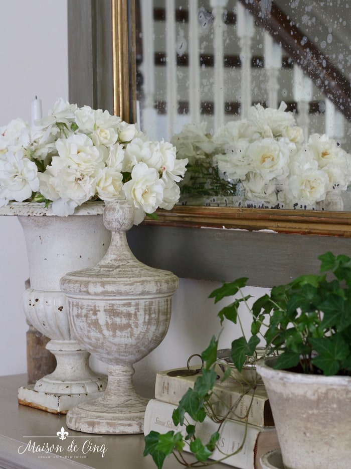 white roses in French vintage urn gorgeous floral display