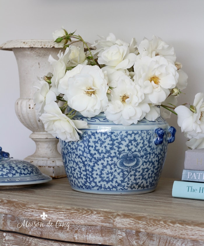 decorating with flowers on a budget white roses in blue and white ginger jar