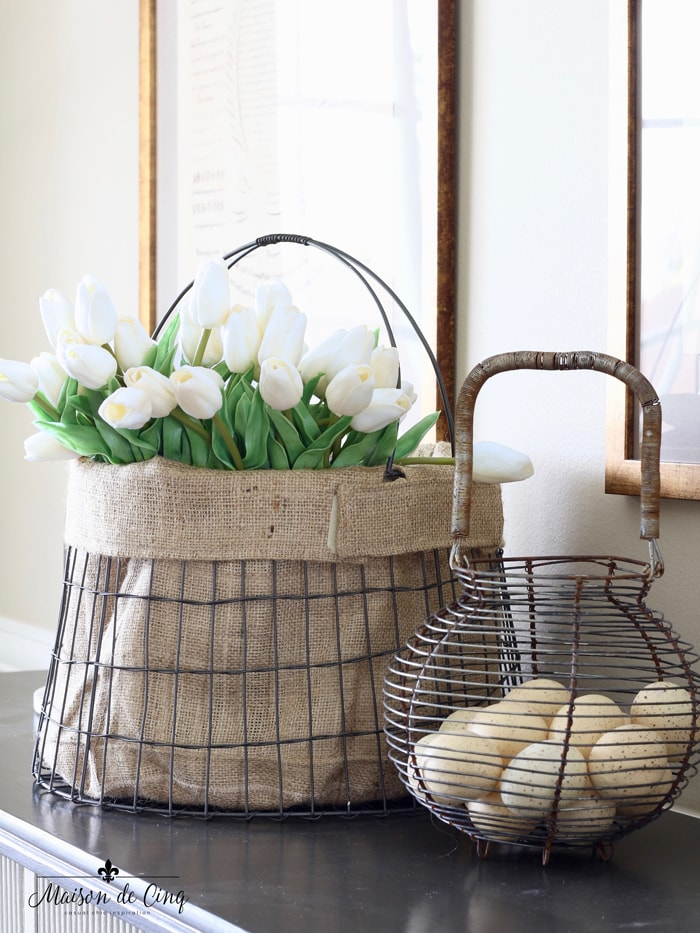 decorating with flowers on a budget white tulips in wire basket