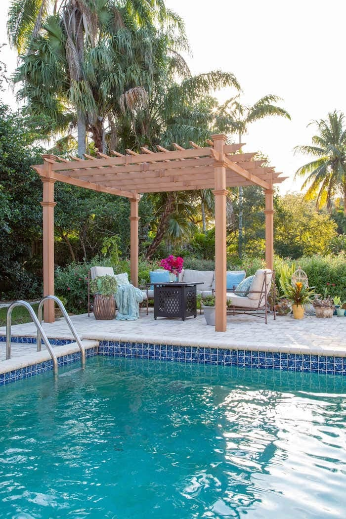 outdoor pool area with cabana seating area